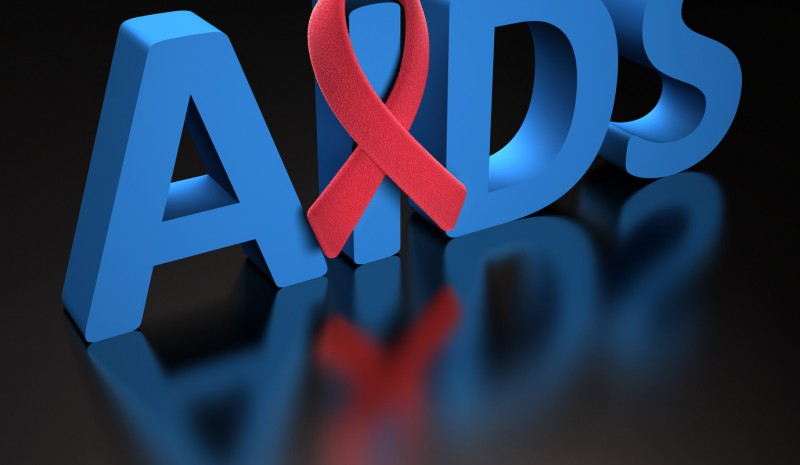 Red ribbon, symbol of a commitment to the fight against HIV/AIDS. Clipping path included.